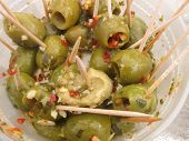 green olives appetizers on toothpicks