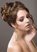 Beautiful woman with evening make-up and hairstyle