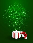 Gift Box On Green Starry Background