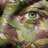 Camouflage Painted On A Face With Green Eye
