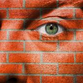 Face With Green Eye Painted With Wall