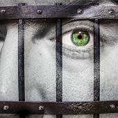 Face With Green Eye And Painted Prision