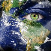 Earth continents and oceans painted on face - Elements of this image furnished by NASA