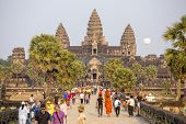 ANGKOR, CAMBODIA - MARCH 11: Tourists visit the historic Angkor Wat temple complex on March 11, 2014 in Angkor, Cambodia. The UNESCO world heritage site attracted 1.12 mln visitors in Q2 of 2013.