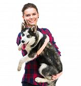 young women with her puppy Husky in the studio. Isolated on white background