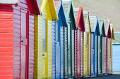 Row Of Colorful Wooden Beach Huts
