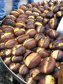 stock photo of peddlers  - Roasted chestnuts are sold by street vendors in downtown Rome - JPG