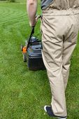 Man Mowing Home Garden Lawn