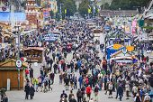 MUNICH, GERMANY - SEPTEMBER 30, 2013: Visitors explore the Theresienwiese Oktoberfest fair grounds.