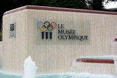 LAUSANNE, SWITZERLAND - JULY 5, 2014: Fountain and Sign at the Olympic Museum. The Museum has more t