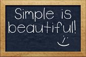 A nice black chalkboard with text simple is beautiful