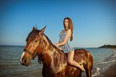 Young Woman Evening Beach Horse Ride