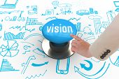 The word vision and businesswoman pointing against blue push button
