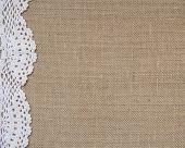 Ecu Burlap background with cream crochet lace