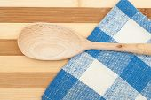 Wooden Spatula On A Blue Dishcloth