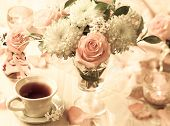 Autumnal table setting with  bunch of autumn flowers and cup of tea,vintage style