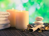 Spa Massage Border Background With Towel Stacked, Candles And Stone