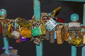 Many Colorful Padlocks Locked Together On A Bridge