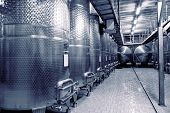 Stainless steel fermenters used to make wine, toned image