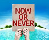 Now Or Never card with a beach on background