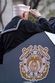 NEW YORK - NOV 11, 2014: A older vet from the US Navy salutes from the Navy Club float as it passes the VIP stage during the 2014 Americas Parade on Veterans Day in New York City on November 11, 2014.