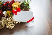 Christmas card and Santa Hat with decorations on wooden background