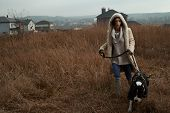 woman on the walk with staffordshire terrier