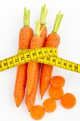 organically grown carrots with tape measure. fresh fruit and vegetables is always healthy. symbolic photo for healthy diet.