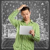 Man looking for Christmas gifts and choosing it