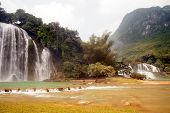 stock photo of ban  - Ban Gioc Falls or Detian Falls are 2 waterfalls located in Daxin County on the Chinese side - JPG