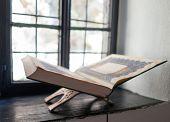Old Koran book on window shelf