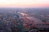 London rooftop view panorama at sunset with urban architectures  with Thames River at night