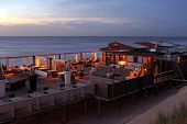 Restaurant at the North Sea coast in the Netherlands at dusk