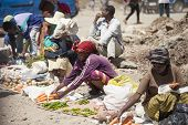ADDIS ABABA, ETHIOPIA-NOVEMBER 1, 2014: Unidentified street merchants sell vegetables in the street in Addis Ababa, Ethiopia