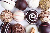 Assortment of chocolates on white background