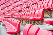 foto of bleachers  - red seats on the stadium steps bleacher - JPG