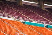 red seats on stadium steps bleacher
