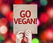 Go Vegan card with colorful background with defocused lights