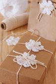 White Crochet Snowflakes For Christmas Decoration Of Gift Box And Paper Package