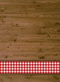 Traditional wooden background with red tablecloth