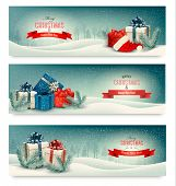 Three Christmas banners with presents.