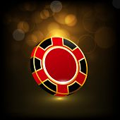 Shiny colorful casino chip on brown abstract background.