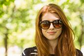 Close up portrait of beautiful young woman wearing sunglasses