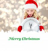 happy festive blonde with clock against merry christmas