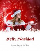 sexy santa girl presenting with hand against feliz navidad