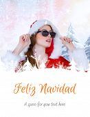 cool santa girl wearing sunglasses against feliz navidad