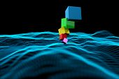 Pile of 3d colourful cubes against abstract glowing black background