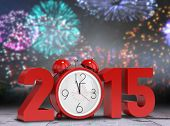 2015 with alarm clock against bleached wooden planks background