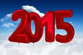 2015 red ballons against bright blue sky with clouds