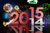 2014 and 2015 against colourful fireworks exploding on black background